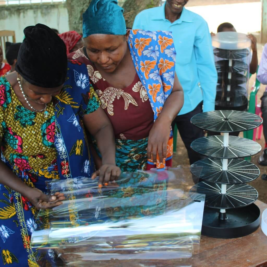 Women in Tanzania assembling a dehydrator to help solve their pain point of food loss