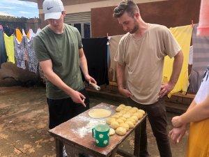 Josh learning to make samosas